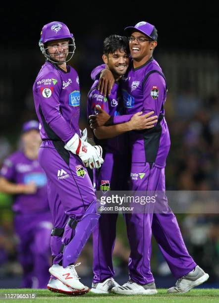 Qais Ahmad of the Hurricanes celebrates with Matthew Wade and Clive Rose after dismissing Aaron Finch of the Renegades during the Hurricanes v...