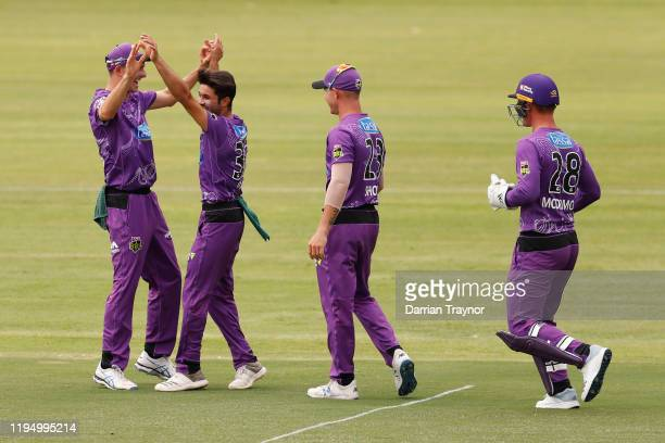 Qais Ahmand of the Hurricanes celebrates a wicket during the Big Bash League match between the Hobart Hurricanes and the Sydney Sixers at Traeger...