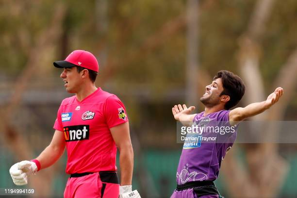 Qais Ahmand of the Hurricanes celebrates the wicket of Moises Henriques of the Sydney Sixers during the Big Bash League match between the Hobart...