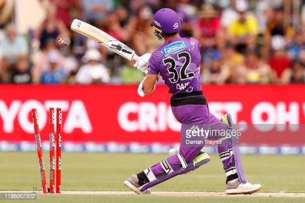 Qais Ahmand of the Hurricanes is bowled during the Big Bash League match between the Hobart Hurricanes and the Sydney Sixers at Traeger Park on...