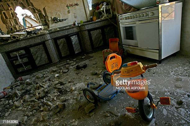 Toys lie among the ruins of a kitchen inside a damaged house in the Lebanese southern village of Qana 31 July 2006 one day after Israel air strikes...
