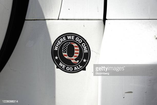 QAnon bumper sticker is seen on a car outside a campaign rally for U.S. President Donald Trump at Yuma International Airport in Yuma, Arizona, U.S.,...