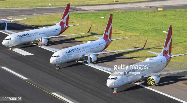 Qantas 737-800 aircraft parked on the east-west runway at Sydney Airport due to lack of parking on May 20, 2020 in Sydney, Australia. Since the...