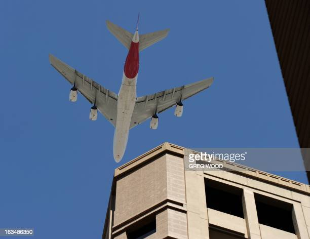 A Qantas A380 Airbus flies low over Sydney's CBD on February 11 as a mark of respect for former Qantas CEO James Strong who died last week aged 68 A...