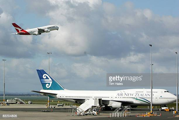 Qantas A380 Airbus takes off in front of an Air New Zealand 747 at Auckland International Airport October 10 2008 in Auckland New Zealand The...