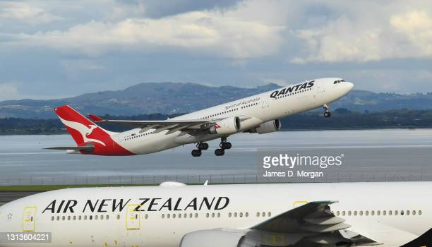 Qantas Airbus A330 aircraft takes off destined for Sydney next to Air New Zealand aircraft at the International Airport on April 19, 2021 in...