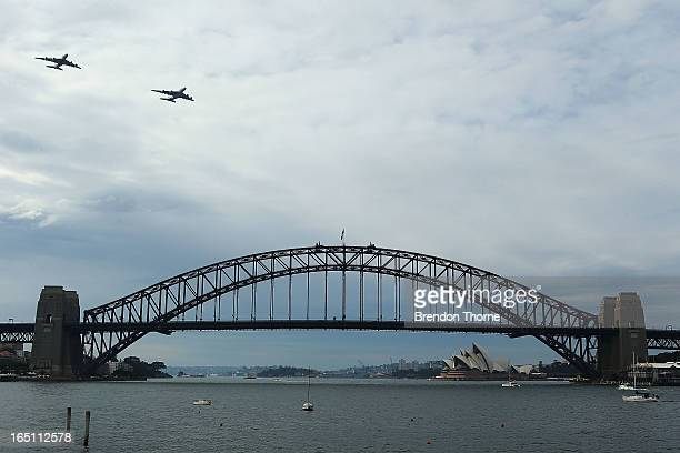 Qantas Airbus A380 and Emirates Airbus A380 fly over Sydney Harbour on March 31 2013 in Sydney Australia The two Airbus A380s display is believed to...