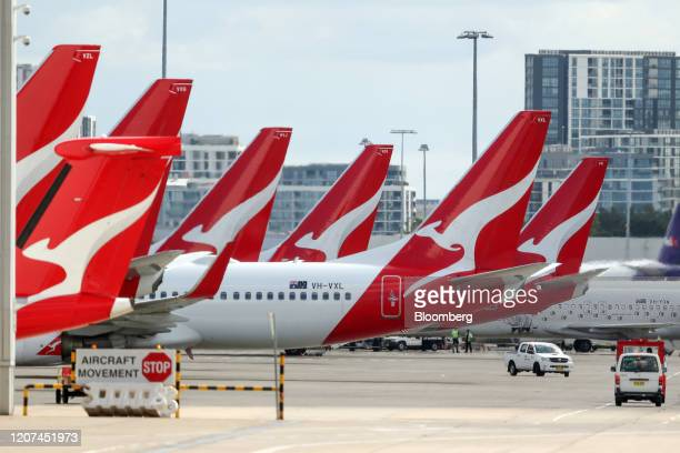 Qantas Airways Ltd. Aircraft stand on the tarmac at Sydney Airport in Sydney, Australia, on Tuesday, March 17, 2020. Qantasis cutting almost all...
