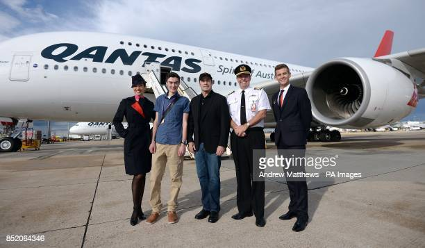 Qantas ambassador John Travolta in front of a Qantas Airbus A380 alongside Captain Geoff King Qantas cabin crew Angela Harding Luke Damen and Tom...