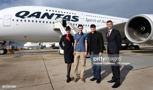 Qantas ambassador John Travolta in front of a Qantas Airbus A380 alongside Qantas cabin crew Angela Harding Luke Damen and Tom Hall 18 from Perth...