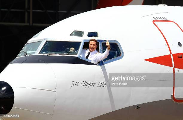 Qantas Ambassador John Travolta waves to the crowd as he arrives at Qantas' 90th birthday celebrations at Sydney International Airport on November 6...