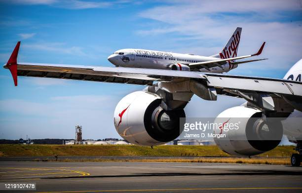 Qantas and Virgin Australia planes at Kingsford Smith International airport on November 15, 2019 in Sydney, Australia.