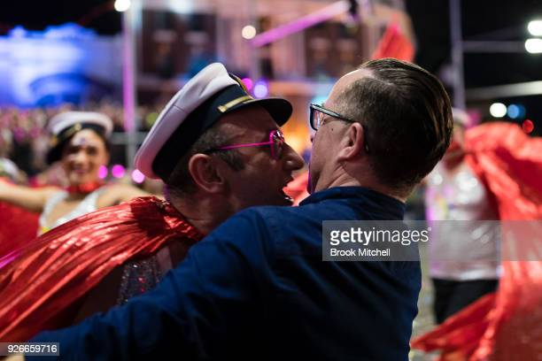 Qantas CEO Allan Joyce avoids a stray kiss during the 2018 Sydney Gay Lesbian Mardi Gras Parade on March 3 2018 in Sydney Australia The Sydney Mardi...