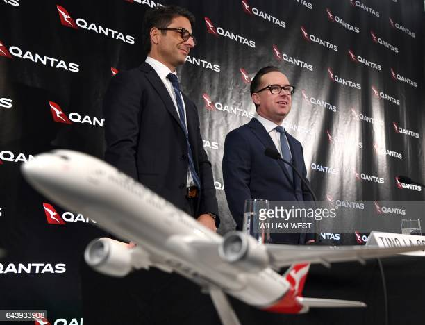 Qantas chief financial officer Tino La Spina and chief executive officer Alan Joyce arrive for a press conference for the announcement of the...