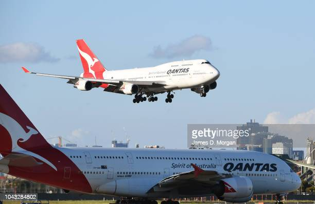 Qantas flight number 4 from Honolulu a Boeing 747400 aircraft flies over a Qantas A380 as she arrives at Sydney Airport on September 30 2018 in...