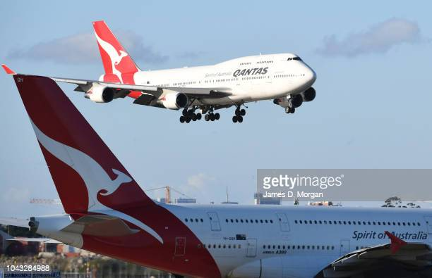 Qantas flight number 4 from Honolulu a Boeing 747400 aircraft flies over a Qantas A380 aircraft as she arrives at Sydney Airport on September 30 2018...