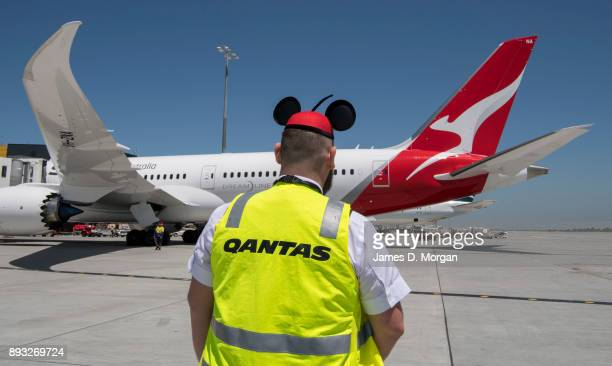 Qantas member of staff wears Mickey Mouse ears as the first commercial flight of the Qantas Boeing 787 Dreamliner aircraft takes off from Tullamarine...