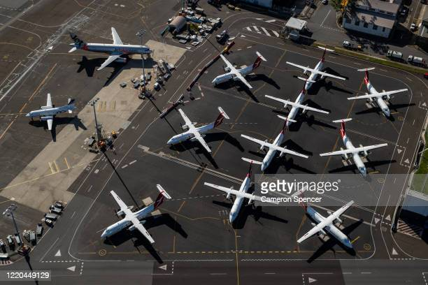 Qantas planes are parked on the tarmac at Sydney Airport on April 22, 2020 in Sydney, Australia. Restrictions have been placed on all non-essential...