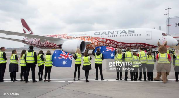 Qantas staff wave goodbye to flight QF10 as she leaves the gate from Heathrow en route to Perth Australia on March 25 2018 in London United Kingdom...