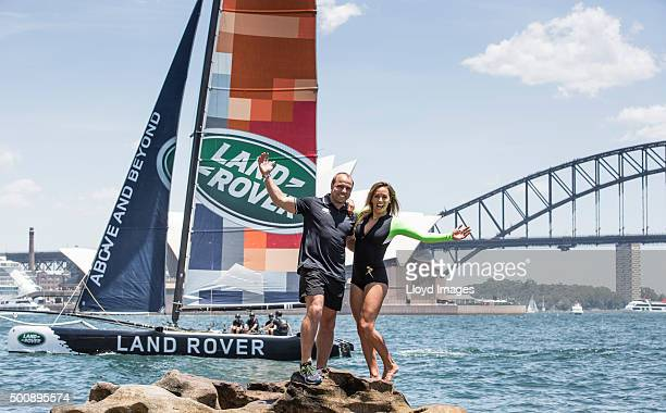 Qantas Wallabies rugby player Phil Waugh and pro surfer Sally Fitzgibbons next to the LandRover extreme 40 catamaran in Sydney Harbour prior to...
