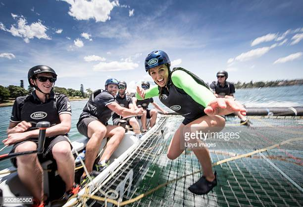 Qantas Wallabies rugby player Phil Waugh and pro surfer Sally Fitzgibbons onboard the LandRover extreme 40 catamaran in Sydney Harbour prior to...