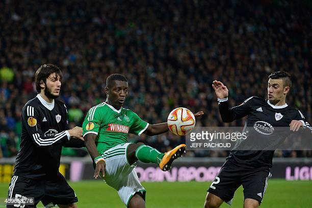 Qarabag Agdam's Azeri defender Badavi Guseynov and Qarabag Agdam's Azeri midfielder Gara Garayev vies with St Etienne's Ivorian forward MaxAlain...