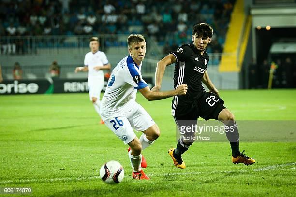 Qarabag FK Afran Ismayilov is challenged by Slovan Liberec Lukas Bartosak during the UEFA Europa League group J football match Qarabag vs Slovan...