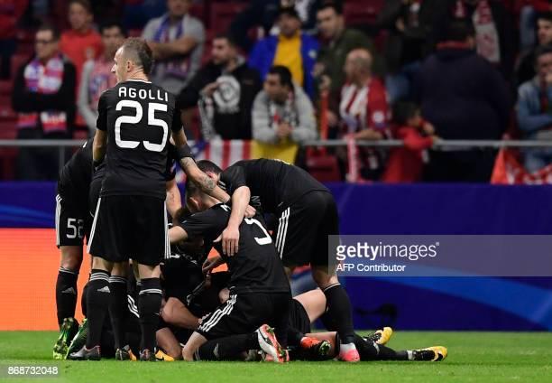 Qarabag players celebrate the opening goal during the UEFA Champions League football match Club Atletico de Madrid vs Qarabag FK at the Wanda...