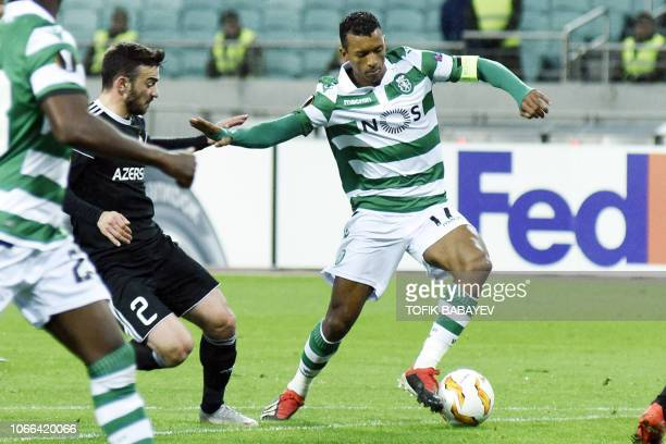 Qarabag's Azerbaijan defender Gara Garayev and Sporting Lisbon's Portuguese midfielder Nani vie for the ball during the UEFA Europa League group E...