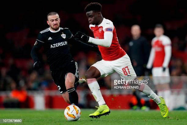 Qarabag's Azerbaijan defender Gara Garayev vies with Arsenal's English striker Bukayo Saka during their UEFA Europa league Group E football match...