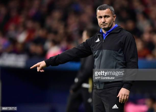 Qarabag's Azerbaijani coach Gurban Gurbanov gestures during the UEFA Champions League football match Club Atletico de Madrid vs Qarabag FK at the...
