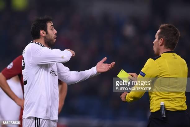 Qarabag's Azerbaijani defender Elvin Yunuszada receives a yellow card from German referee Tobias Stieler during the UEFA Champions League Group C...