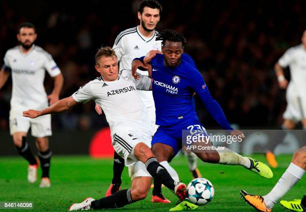 Qarabag's Azerbaijani defender Maksim Medvedev vies with Chelsea's Belgian striker Michy Batshuayi during the UEFA Champions League Group C football...