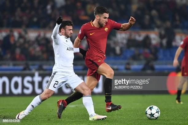 Qarabag's Azerbaijani midfielder Gara Garayev fights for the ball with Roma's Dutch midfielder Kevin Strootman during the UEFA Champions League Group...