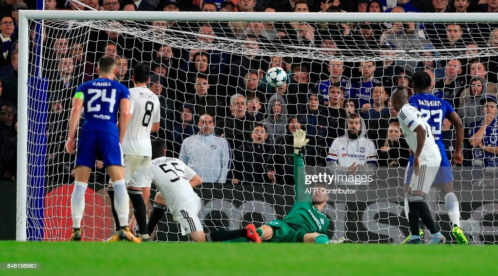 Qarabag's Bosnian goalkeeper Ibrahim Sehic (C) fails to save a shot from Chelsea's French midfielder Tiemoue Bakayoko (unseen), resulting in Chelsea's fourth goal, during the UEFA Champions League Group C football match between Chelsea and Qarabag at Stamford Bridge in London on September 12, 2017. / AFP PHOTO / Adrian DENNIS