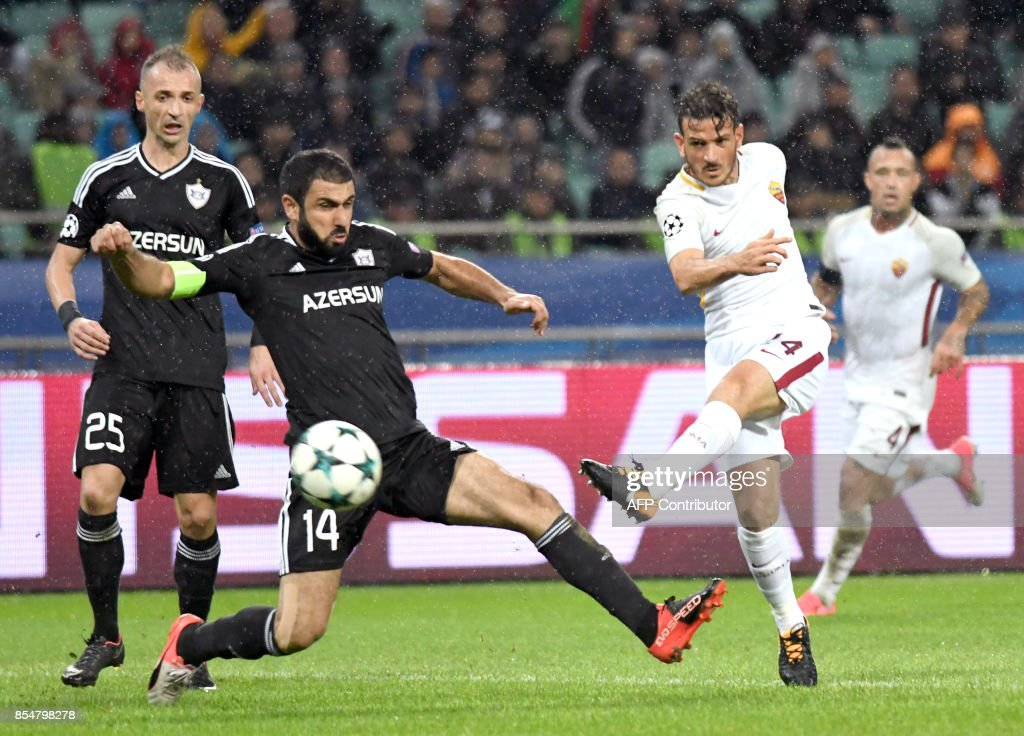 Qarabag's defender from Azerbaijan Rashad Sadygov and Roma's midfielder from Italy Alessandro Florenzi vie for the ball during the UEFA Champions League Group C football match between Qarabag FK and AS Roma in Baku on September 27, 2017. / AFP PHOTO / Vano Shlamov
