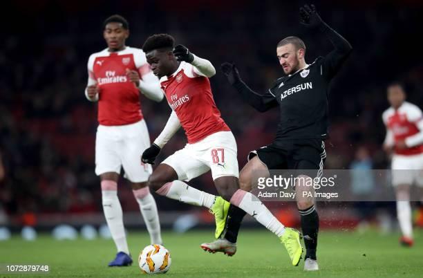 Qarabag's Gara Garayev fouls Arsenal's Bukayo Saka during the UEFA Europa League group E match at Emirates Stadium London