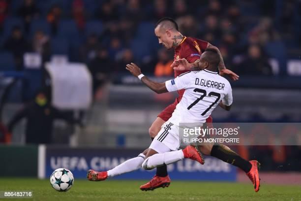 TOPSHOT Qarabag's Haitian midfielder Donald Guerrier vies with Roma's Belgian midfielder Radja Nainggolan during the UEFA Champions League Group C...