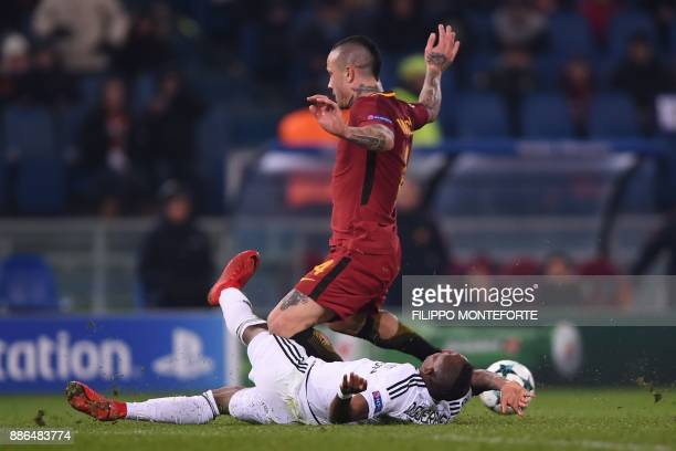 Qarabag's Haitian midfielder Donald Guerrier vies with Roma's Belgian midfielder Radja Nainggolan during the UEFA Champions League Group C football...