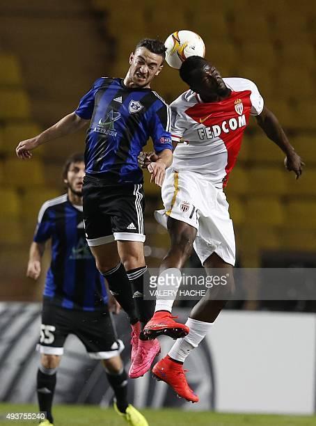 Qarabag's midfielder Gara Garayev and Monaco's Ivorian forward Lacina Traore go for a header during the Europa League Group J football match AS...