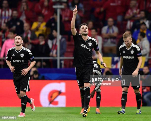 Qarabag's Spanish midfielder Michel celebrates a goal during the UEFA Champions League football match Club Atletico de Madrid vs Qarabag FK at the...