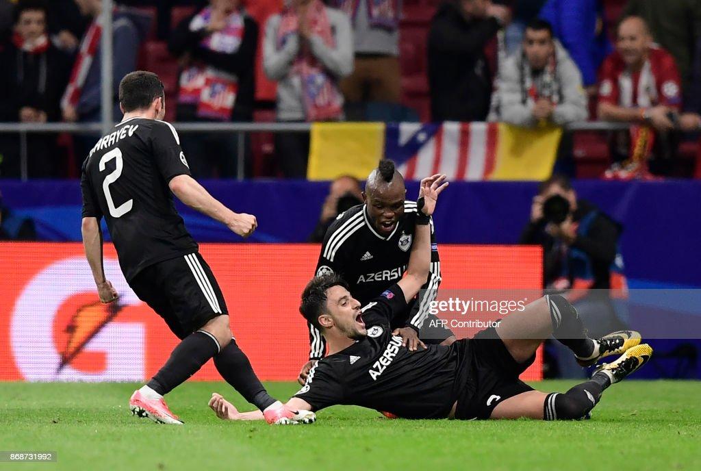 Qarabag's Spanish midfielder Michel (bottom) celebrates a goal during the UEFA Champions League football match Club Atletico de Madrid vs Qarabag FK at the Wanda Metropolitano stadium in Madrid on October 31, 2017. /