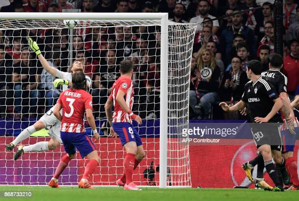 Qarabag's Spanish midfielder Michel looks at the ball after scoring a goal during the UEFA Champions League football match Club Atletico de Madrid vs...