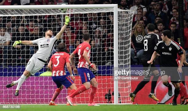 Qarabag's Spanish midfielder Michel scores a goal during the UEFA Champions League football match Club Atletico de Madrid vs Qarabag FK at the Wanda...