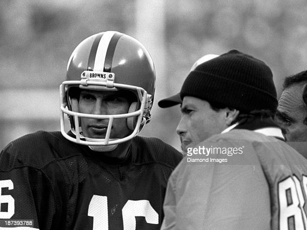 Qarterbacks Paul McDonald and Brian Sipe of the Cleveland Browns talk on the sideline during a game against the Houston Oilers on October 30 1983 at...