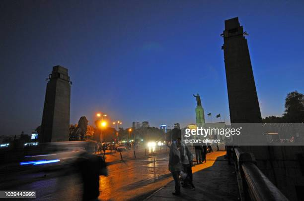 Qasr alNil bridge with the Saad Zaghloul monument is a busy access road to Tahrir Square in Cairo Egypt 28 June 2013 The bridge connects the Nile...