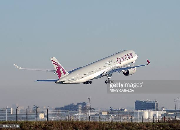 A Qatar Airways A350 takes off from the Airbus headquarters in Toulouse on December 22 2014 Airbus delivered its first nextgeneration A350900 plane...