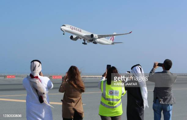 Qatar Airways Airbus A350 airplane takes off from Hamad International Airport near the Qatari capital Doha, on the first commercial flight to Saudi...