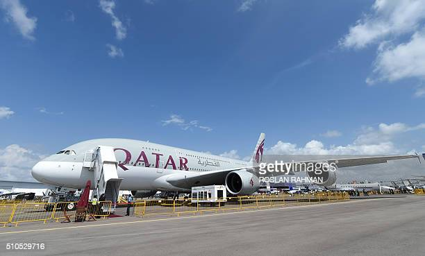 A Qatar Airways Airbus A380 plane is seen at the static display during the Singapore Airshow at the Changi exhibition centre in Singapore on February...