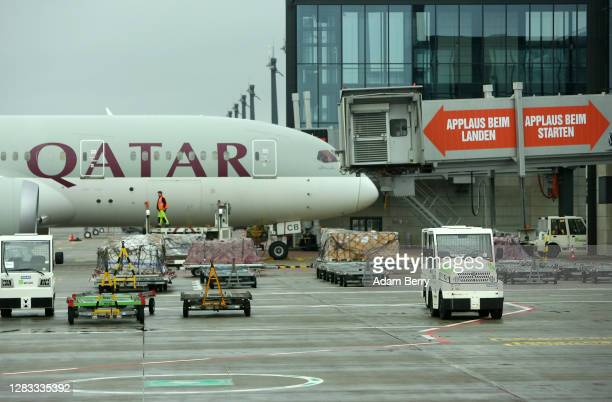 Qatar Airways airplane sits at a gate on the first full day of public operation of the new BER Berlin Brandenburg Airport on November 1, 2020 in...